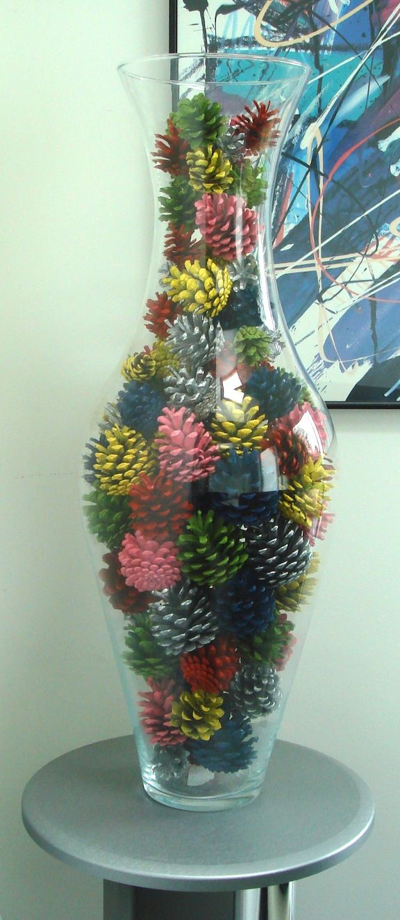 Painted pine cones-could put them in an oil lamp globe