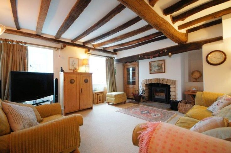 Cosy lounge with original beams and multi-fuel stove