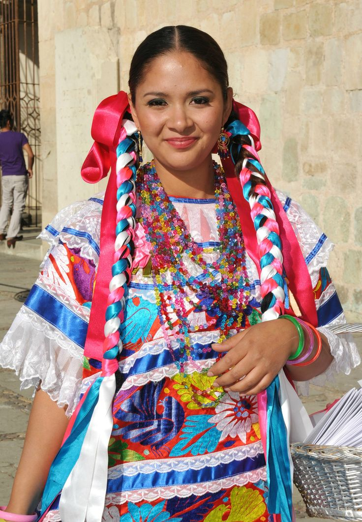 Oaxaca Mexico Mexicana | This woman is dressed in a pretty Mazatec huipil to serve as an attendant at a wedding in Oaxaca city