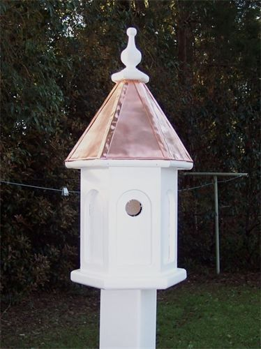 Handcrafted copper top birdhouse Due to shipping problems, I do not include the vinyl post needed to install. The post are available at all home improvement stores. It is 4X4X72 vinyl post sleeve. Once the post is set in ground, the bird feeder simply mounts on top(no hardware needed) Dimensions are 24 inches high and 11 inches wide This photo only shows one entrance hole. There is another one on the other side at a lower level. This is a duplex birdhouse.  Price: $125.00