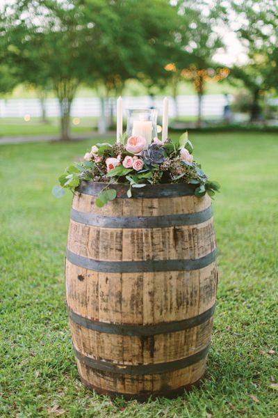 whiskey barrel for the unity candles via Ashleigh Jayne http://www.himisspuff.com/rustic-country-wine-barrel-wedding-ideas/6/