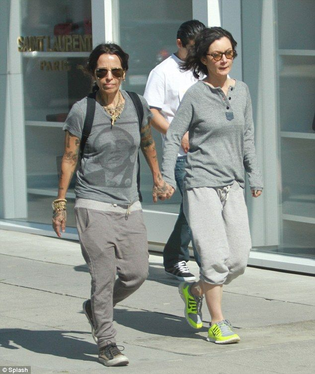 Roseanne star Sara Gilbert and fiancé Linda Perry hold hands on ...