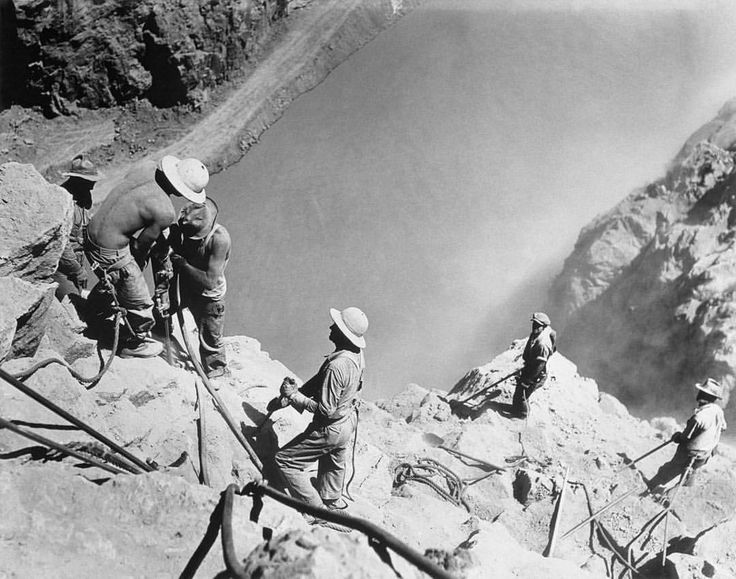 """High scalers"" use jackhammers to shave loose rock off the walls of Black Canyon during the construction of the Hoover Dam, 1935."