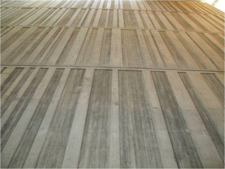 textured concrete walls- create bays