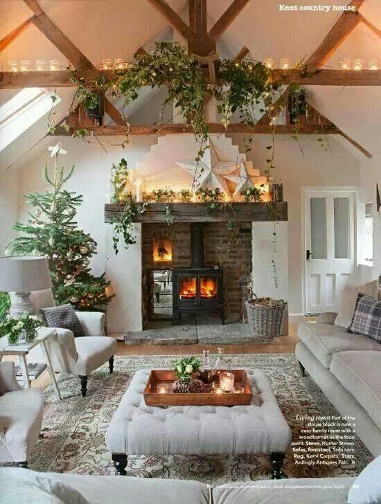 This looks very cozy living family rooms pinterest stove fireplaces and ottomans - Deco noel salon ...