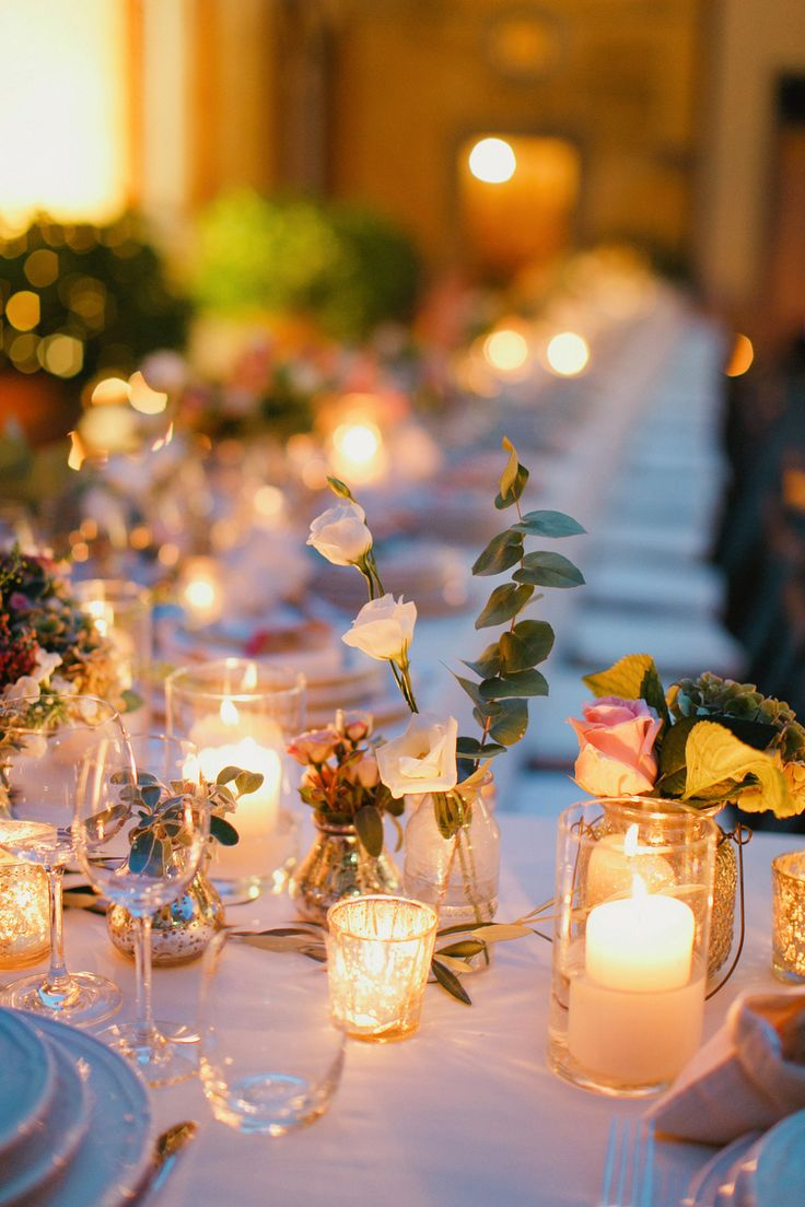 Pillar Candles in Centerpiece | photography by http://www.cinziabruschini.it Flowers by Jardin Divers www.jardindivers.it @jardindivers wedding in italy, italian wedding, tuscany wedding, romantic wedding, flower wedding, outdoor wedding, long table receivement, Casa Mora