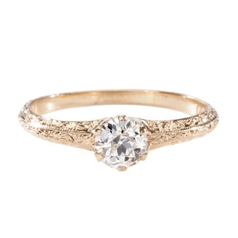 Featuring delicate hand-engraving reminiscent of vintage rings and an authentic Old European cut diamond, circa 1910, this incredible engagement ring is perfect for the woman who wants something unique.  Single Stone at Greenwich Jewelers. $2500