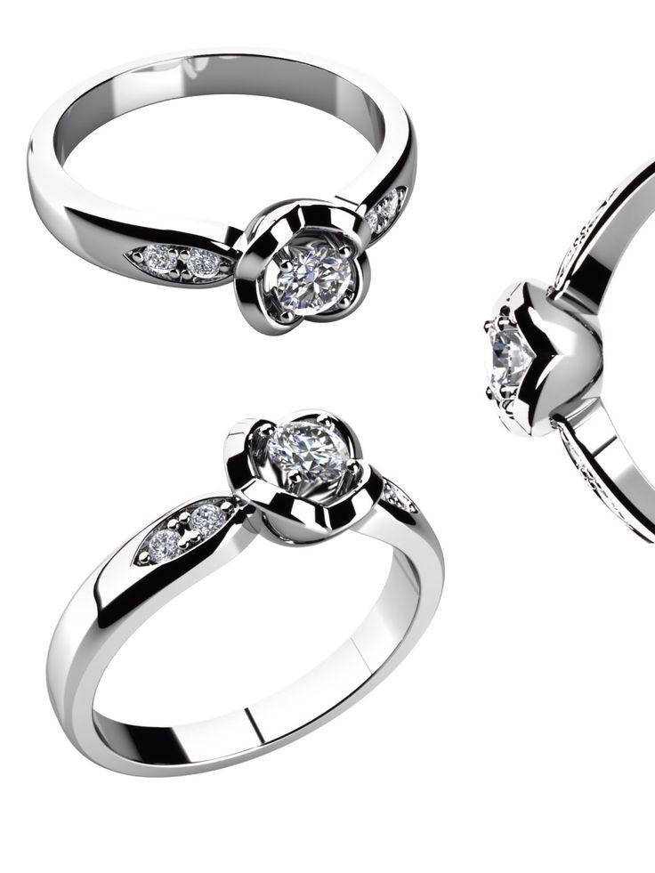 Zásnubní prsten - model LOVE 067s korunkou připomínající rozkvetlou květinu je tím ideálním k romantické žádosti o ruku. Korunka uchovává jeden oslnivý kámen, čtyři menší se třpytí po jeho bocích.