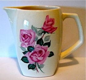 The design is Fashion Rose Pat.No. 750; Crown Lynn 849-2 shape   ( later known as 6025) which measures 140mm High and holds3 cups or 700Mls