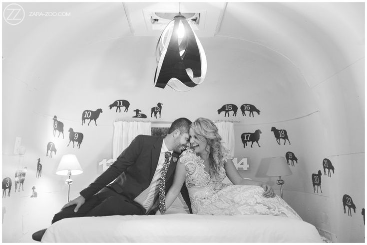 Spontaneous laughing, couple photos inside a Luxury trailer. Wedding at Old Mac Daddy. Counting sheep...