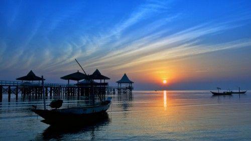 morning sun at kenjeran by andrey kurniawan