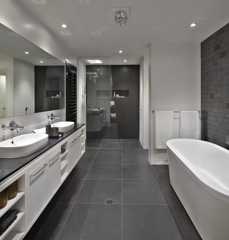 Bathroom: floor to roof charcoal tiles with a black counter and grey cabinets everything else white and clear shower screens