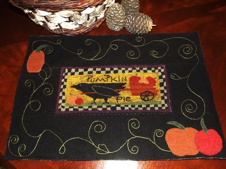 Primitive Crow and Pumpkins Table Mat; Punch Needle Crow with Pumpkins on Upcycled Wool Mat; Crow and Pumpkins Candle Mat by BoothValleyHomemades on Etsy https://www.etsy.com/listing/248002565/primitive-crow-and-pumpkins-table-mat