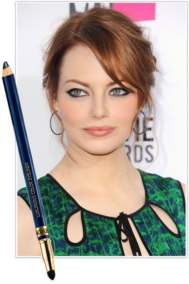 THE BEST NEW SMOKY EYE LOOKS - Emma Stone  For a new twist on black, stroke on navy liner and top it with cream shadow in a similar shade, patting it in with your fingers for a lived-in effect.