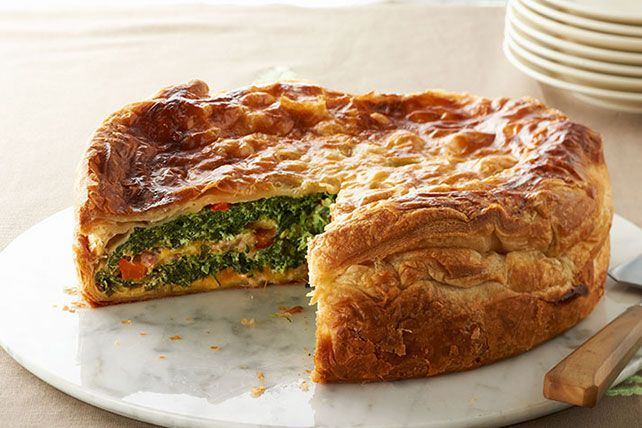 All we ask of brunch is that it knock our socks off. And this make-ahead bake with puff pastry-wrapped bacon, cheesy eggs and spinach does just that.
