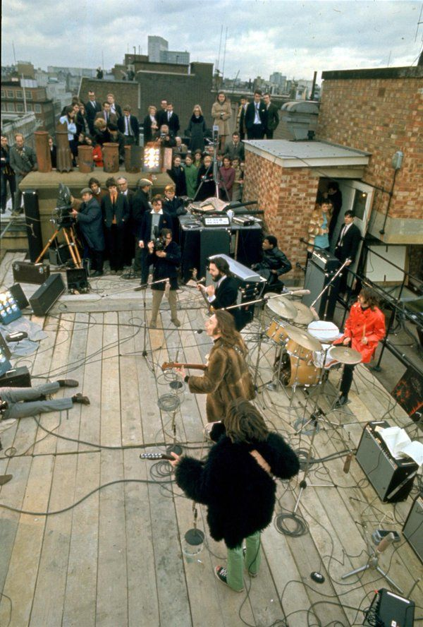 The Beatles in their final concert on the roof of Apple Records, 1969.