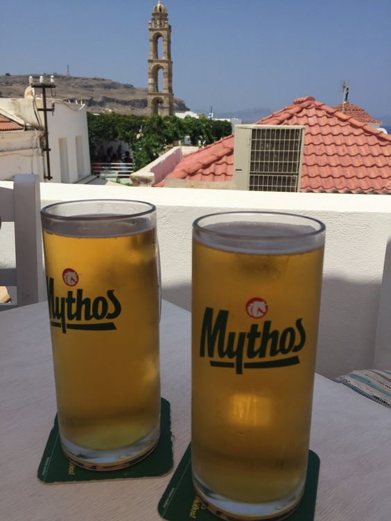 Mythos and a great view from our roof top. — at El Greco Steakhouse Restaurant.