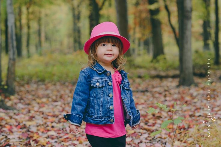 Girl in a hat in the woods