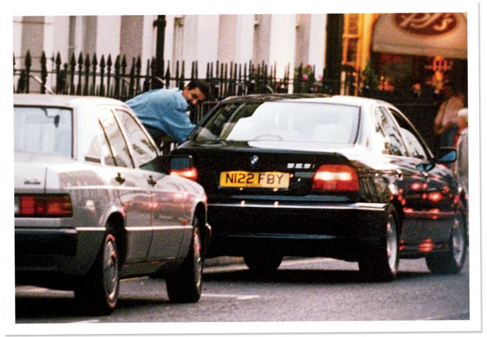 Hasnat Khan leans into Princess Diana's BMW, near the Royal Brompton Hospital, London, 1996. With some success, Diana worked hard to keep the press away from Khan.,