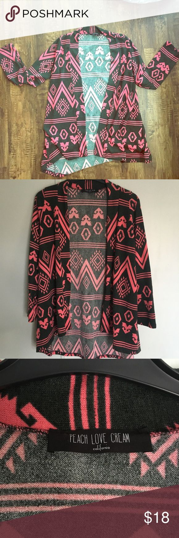 Tribal print cardigan Tribal print cardigan with coral pink and a greenish black color Great condition... there is no tag with the size, but I generally wear a medium, and it fit well. Peach Love California Sweaters Cardigans