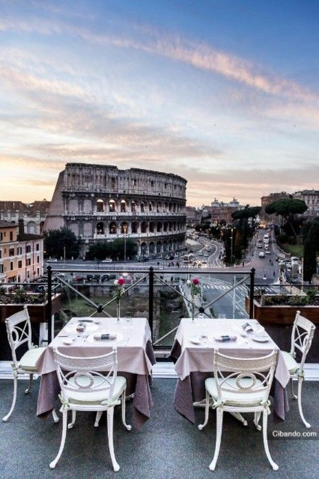 what a view: aperitivi overlooking the colosseum in rome.