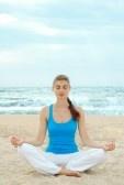 Yoga : Beautiful woman practice yoga on the beach