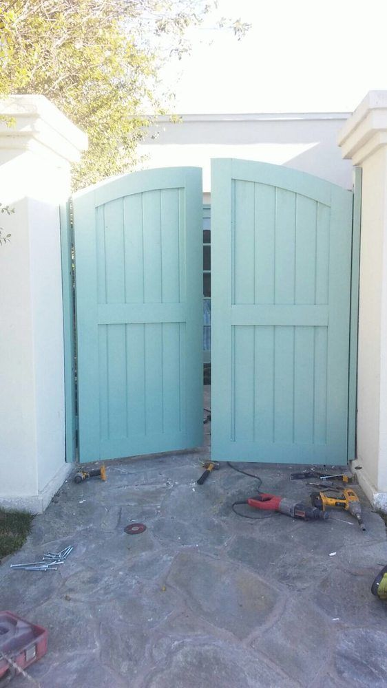 Photo of OC Local Garage Door & Gate - Costa Mesa, CA, United States. Supply and install new double swing wooden gate in Newport Beach by oc local garage door and gate