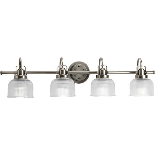 FREE SHIPPING. Purchase the industrial Archie Sconce in Bronze by Progress Lighting today for your bathroom lighting today at lightingconnection.com. Progress Lighting P2989-74