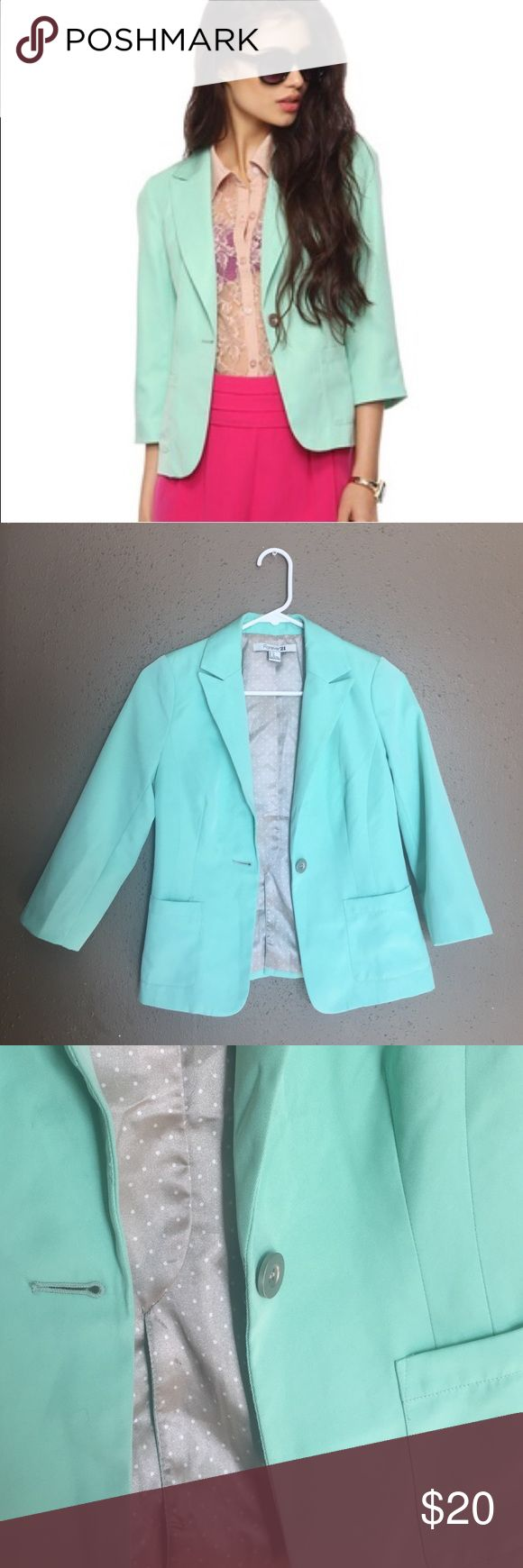 Forever 21 mint blazer Super adorable mint blazer that I am so sad to see leave my closet! The inside is a silk polka dot pattern and the outside has pockets and accent buttons on the sleeves. The material is 100% polyester. No flaws, in amazing condition!! Forever 21 Jackets & Coats Blazers