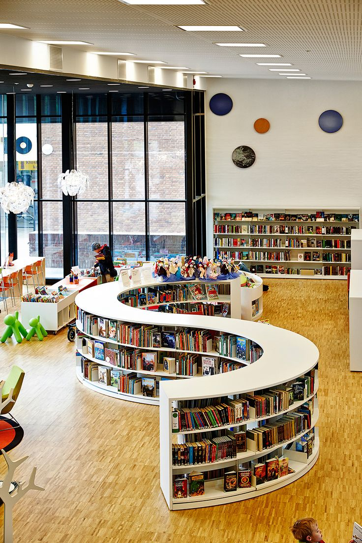 Round Steel Shelving System For Unique Library Design