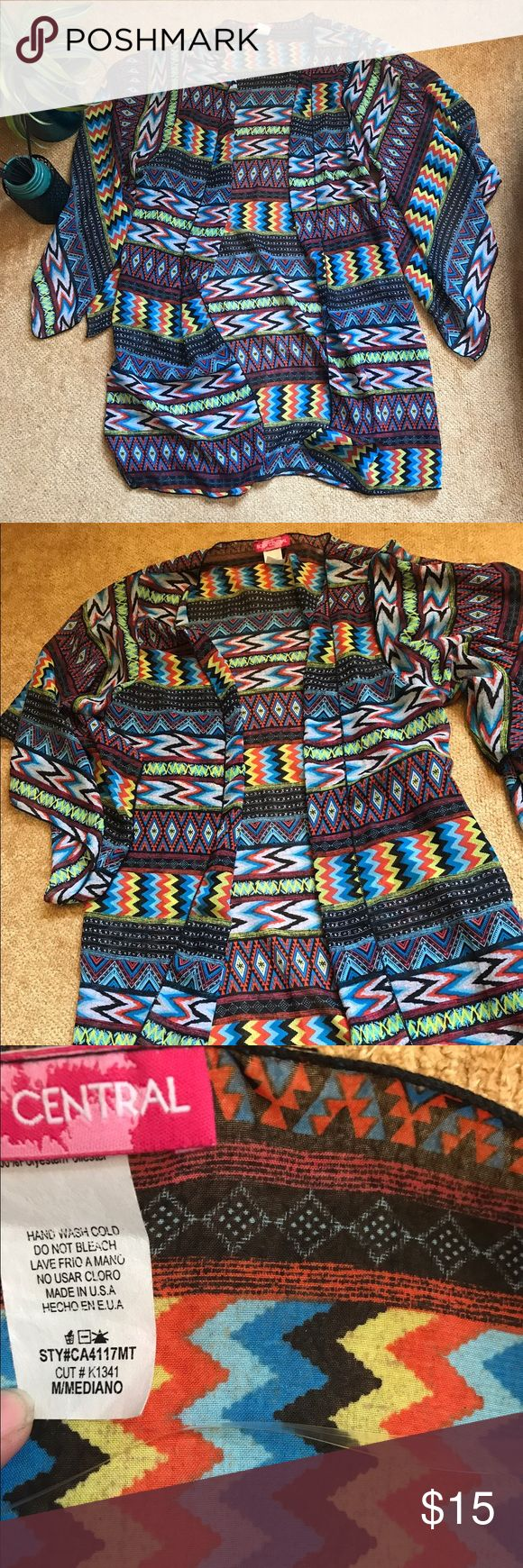 "Tribal Print Kimono Really fun tribal print kimono. Super lightweight 100% Polyester will help keep you cool and covered in the sun! Size medium. I got this from another Posher and while I love it a lot it is longer than I had imagined! 33.5"" top to bottom. I'm 5'9.5 and it hits where my fingers end with my arms straight down! I know there's someone out there that will love it!! Has really cute flutter sleeve design. Really flattering and colorful! Perfect beach cover up or outfit statement…"