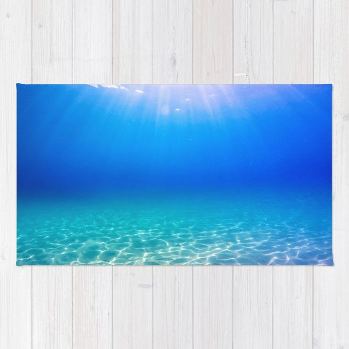 Underwater picture taken in Greece on a beautiful sandbeach with crystal clear water and the sun rays shining through the surface, creating a display of glowing patterns on the bottom. #underwater #water #sea #ocean #beach #summer #travel #adventure #blue #swimming #freediving #diving #rug #homedecor