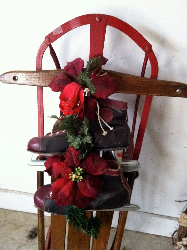 christmas porch decor a decorated antique sled with skates
