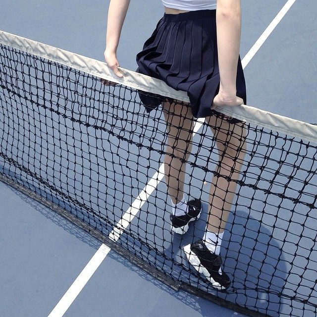 I stand waiting at the net, checking over myself. On days like these I must I must repeat to myself my own point over and over just to grasp it. Navy blue skirt pleated proudly by me. My mom could never bother anymore. Stiff white shirt with school logo. Crew socks with black Nike shoes. Double check. My pale skin is glistening in the bright sun. All the while my mind is sinking, fighting, floating but I just smooth down my straightened hair.