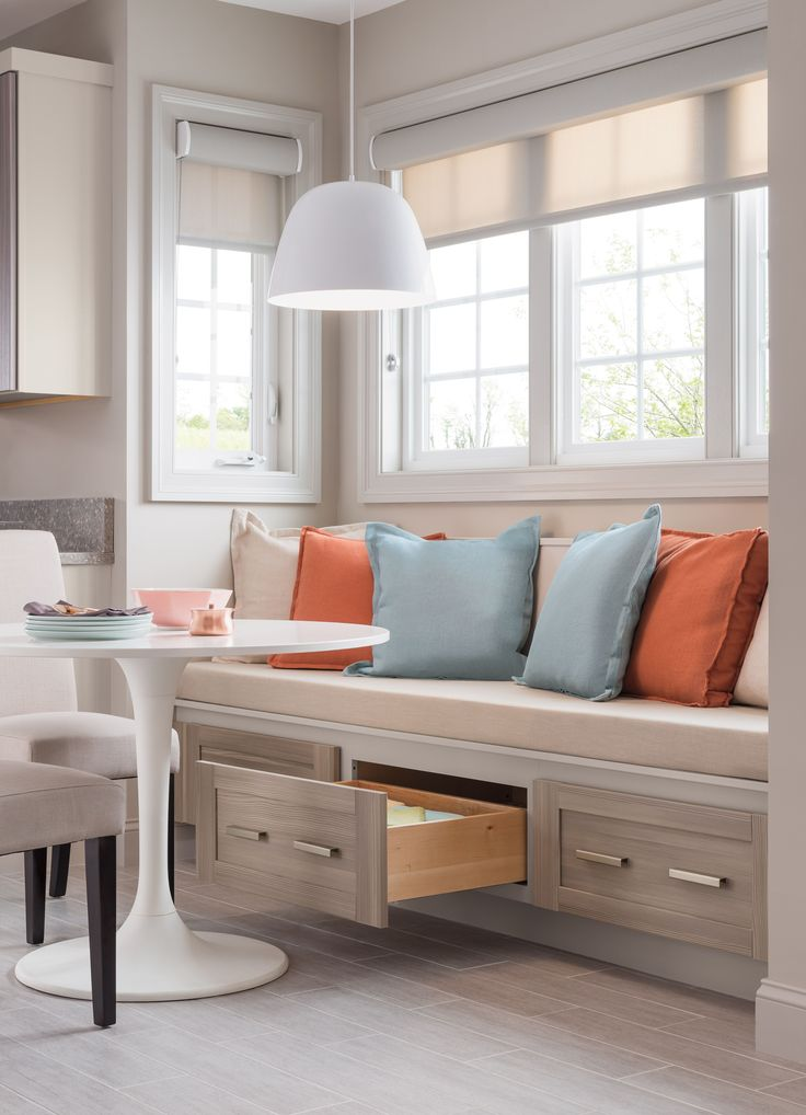 Save space and create more seating using kitchen cabinetry as a bench! Learn how to create the perfect kitchen.