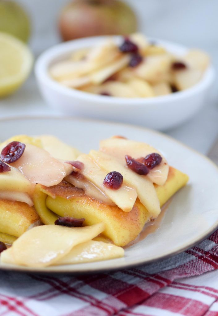 Cheese-filled blintzes with sautéed apples and cranberries: perfect for fall brunches or breakfast-for-dinner. Make ahead!