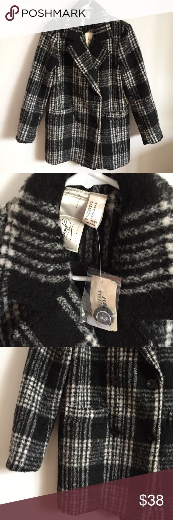 NWT Black & White Plaid Winter Coat Forever 21 A gorgeous warm winter coat from Forever 21, brand new with tags. Black and white checkered plaid design. Button up. Retails $62 Forever 21 Jackets & Coats Pea Coats
