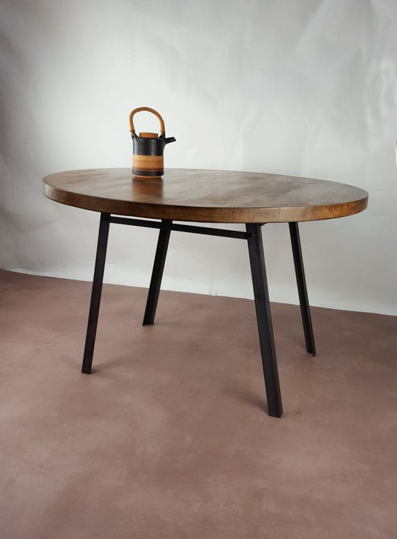 5 Seater Round Table from KONK! Forget the household hierarchy of who sits at the head of the table with this egalitarian piece of industrial