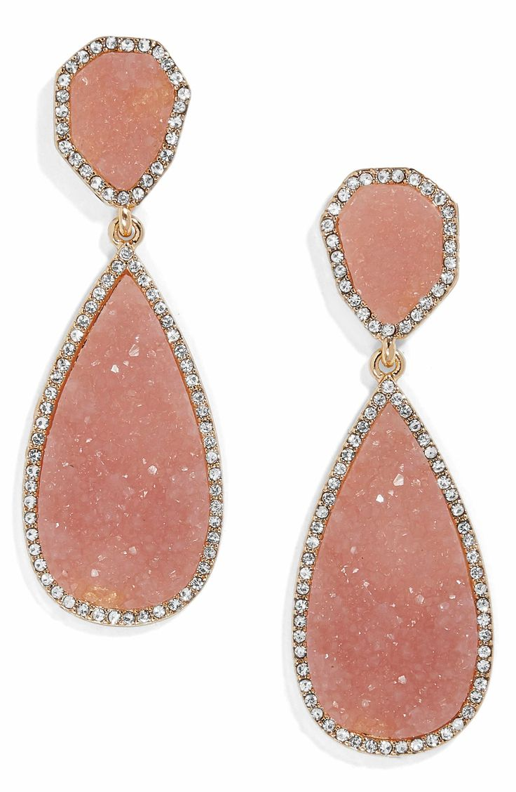 Shimmering stones and crystals exaggerate the vintage sophistication of impeccable teardrop earrings.