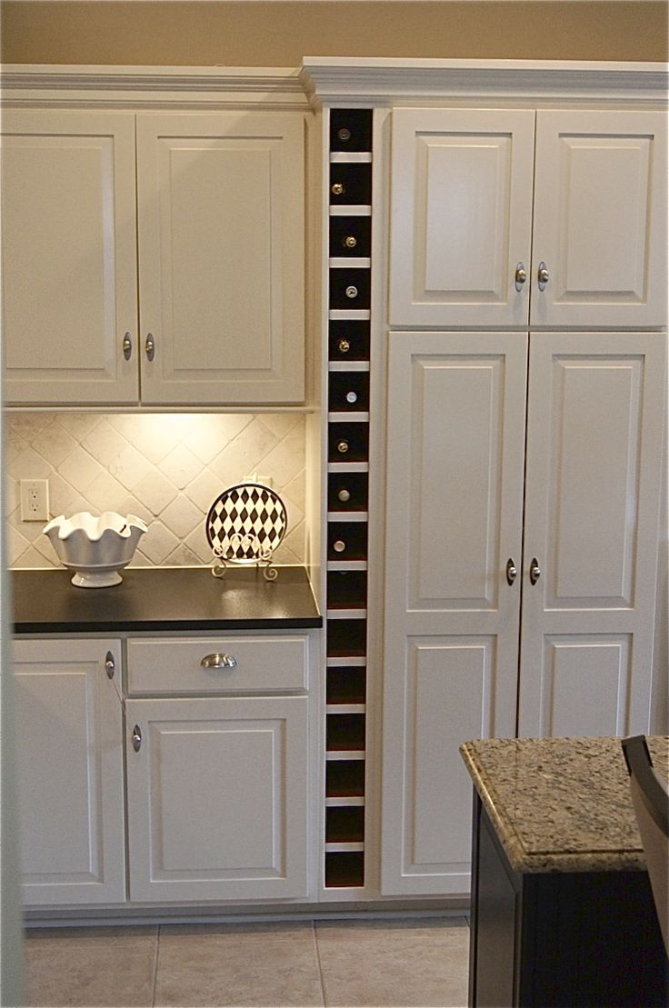 The Yellow Cape Cod: Dramatic Kitchen Makeover~Before and After - LOVE the wine storage!