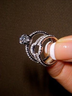 The wedding band fits over the engagement ring. Very clever idea..we ♥ this! moncheribridals.com