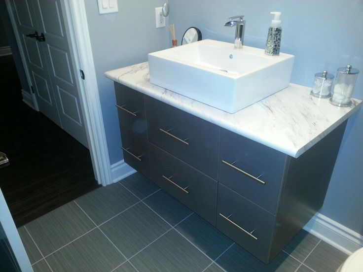 Maple slab wall hung vanity by Raywal Cabinets
