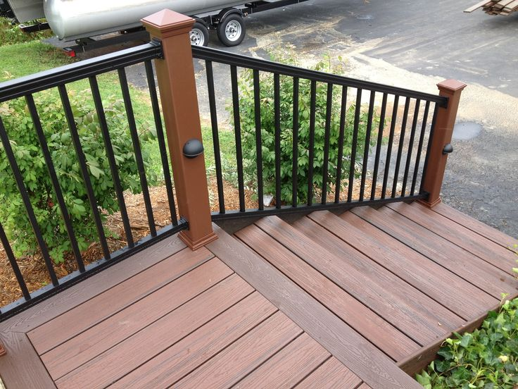 Black aluminum railing with trex posts and pathway