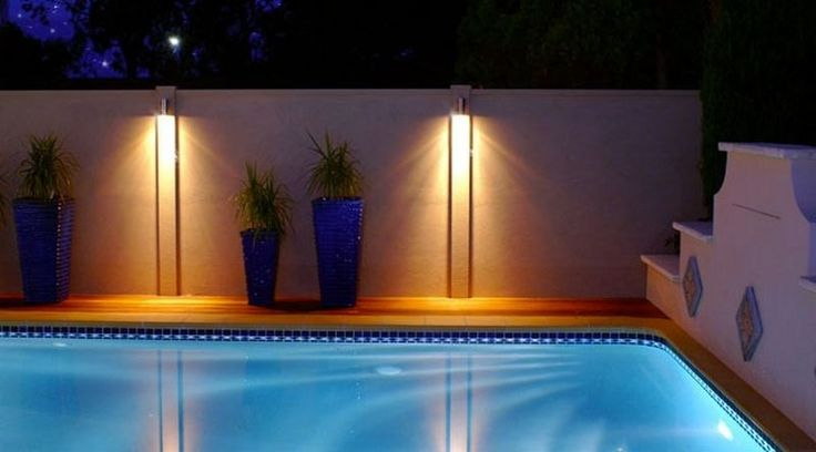 Add some lighting to your ModularWalls pool wall to create magic and serenity in your backyard oasis.