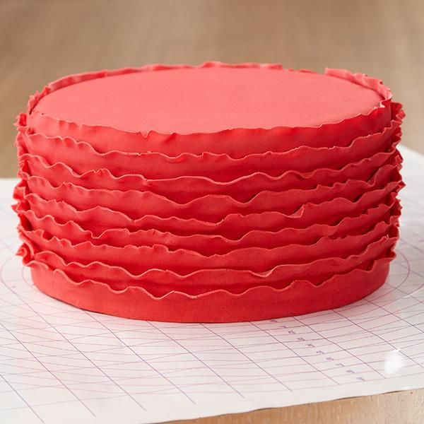 Red Ruffled Ribbons Fondant Cake - Ruffled ribbons provide a contemporary twist to a fondant cake. The ruffled ribbons are easier to create using Wilton Decorator Preferred Red Fondant since it's easier to roll and form.