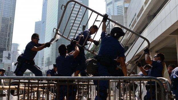 Hundreds of police have used chainsaws and bolt-cutters to dismantle barricades put up by pro-democracy activists near the government offices in Hong Kong. They also re-opened a main thoroughfare in Causeway Bay, a shopping district. It is the second day of operations which police say are to ease traffic disruption, not clear the protesters. Police officers remove barricades during a pro-democracy protest in the Admiralty district of Hong Kong on October 14, 2014