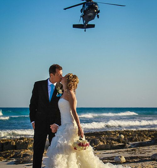 """We were Shooting this Great Wedding at Valentín Imperial Maya, when suddenly a Police """"Chopper"""" passed by, and the guys realized we were doing a photo-session so, they decided to return AND POSE FOR THE PICTURE Behind them!. First and unique moment among avoer 250 weddings done already! IT WAS GREAT!"""