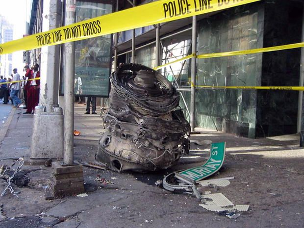 A piece of debris, from one of the crashed airliners, lies on the corner of Murray Street in lower Manhattan near the World Trade Center site in New York on Sept. 11, 2001.