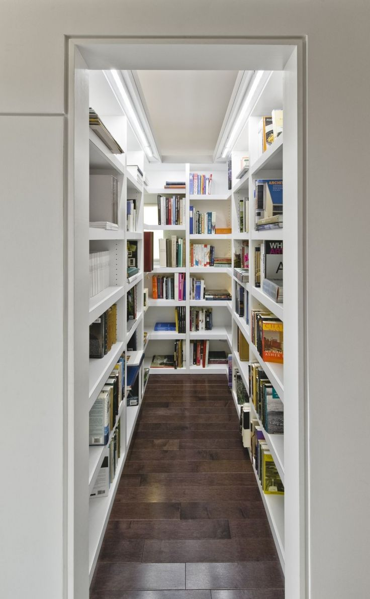 A walk-in closet for books at Echo House in Ottawa, Ontario. Designed by Kariouk Associates.