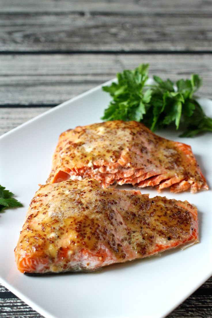 Easy honey-dijon roasted salmon. I left the butter out and no one noticed, so consider it optional!